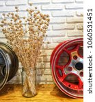 dry grass vase and alloy wheels | Shutterstock . vector #1060531451