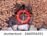 A Red Life Bouy Set Against A...