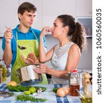 Small photo of Surprised caucasian adults feeling foul smell of food from casserole