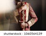strong handsome indian groom... | Shutterstock . vector #1060564139