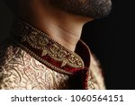 thoughtful indian groom stands... | Shutterstock . vector #1060564151