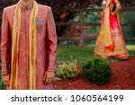 smiling indian groom stands... | Shutterstock . vector #1060564199