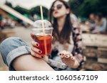 strawberry lemonade in hand.... | Shutterstock . vector #1060567109
