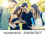 teen group of friends with... | Shutterstock . vector #1060567817