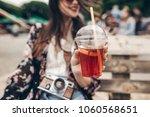 lemonade in hand. happy stylish ... | Shutterstock . vector #1060568651