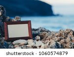 photo frame stone  sea at... | Shutterstock . vector #1060574879