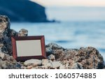 photo frame stone  sea at... | Shutterstock . vector #1060574885
