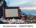 photo frame stone  sea at... | Shutterstock . vector #1060574891