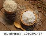 jasmine rice in wood bowl and... | Shutterstock . vector #1060591487