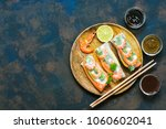 asian food spring rolls with... | Shutterstock . vector #1060602041