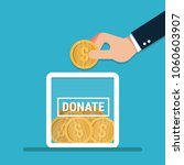 man throws gold coin in a box... | Shutterstock .eps vector #1060603907