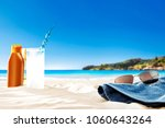 towel on beach and free space... | Shutterstock . vector #1060643264