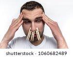 man has a headache and his nose ... | Shutterstock . vector #1060682489