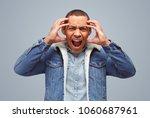 young ethnic man in denim...   Shutterstock . vector #1060687961