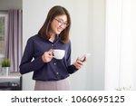 businesswoman using smart phone ... | Shutterstock . vector #1060695125