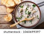 vegetarian soup of wild rice... | Shutterstock . vector #1060699397