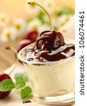 dairy dessert with cherries and chocolate sauce - stock photo