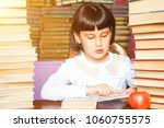 child girl reading books in... | Shutterstock . vector #1060755575