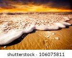 Waves splashing onto the sand - stock photo
