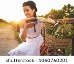 young beautiful woman sitting... | Shutterstock . vector #1060760201