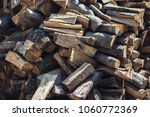 wooden background. firewood for ... | Shutterstock . vector #1060772369