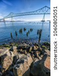 Small photo of Large boulders lead into the image of the landmark bridge in Astoria, Oregon.
