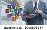 businessman holding tablet with ... | Shutterstock . vector #1060805159