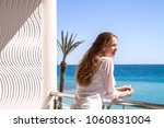 the beautiful girl standing on... | Shutterstock . vector #1060831004
