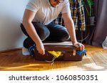 man need help to close suitcase.... | Shutterstock . vector #1060850351