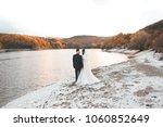 bride and groom standing over...   Shutterstock . vector #1060852649