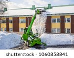 roof shoveling   removing snow... | Shutterstock . vector #1060858841