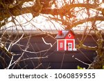 red birdhouse barn hanging in a ...   Shutterstock . vector #1060859555