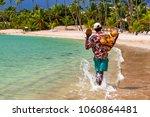 coconut saler walking by the...   Shutterstock . vector #1060864481