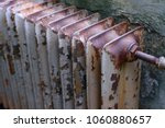 old obsolete rusty radiator.... | Shutterstock . vector #1060880657