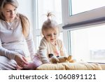 mother with little daughter at... | Shutterstock . vector #1060891121