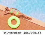 slim woman in bikini relaxing... | Shutterstock . vector #1060895165