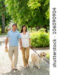 Stock photo couple in love walking labrador dog in park sunny day 106090904
