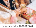 priest holding cross on groom... | Shutterstock . vector #1060922444