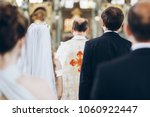 priest and groom and bride... | Shutterstock . vector #1060922447