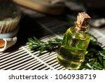oil bottle. green leafs....   Shutterstock . vector #1060938719
