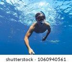 sharks swimming in bora bora... | Shutterstock . vector #1060940561