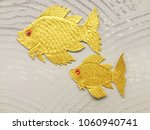 Goldfish Carved On Gray Wall