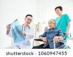 asian doctor explain x ray flim ... | Shutterstock . vector #1060947455