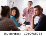 meeting at the office. a young... | Shutterstock . vector #1060965785