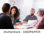 meeting at the startup office.... | Shutterstock . vector #1060965935