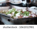 steam squid with spicy chili... | Shutterstock . vector #1061012981