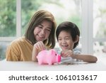 cute asian child and mother... | Shutterstock . vector #1061013617
