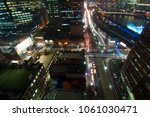 busy city night life at... | Shutterstock . vector #1061030471