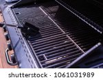 cleaning bbq grill for grilling ... | Shutterstock . vector #1061031989