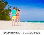 young happy family having fun... | Shutterstock . vector #1061035421